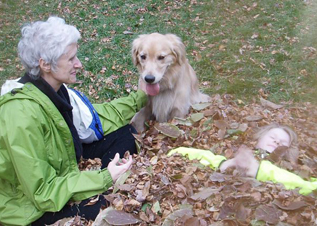 Sara, her granddaughter, and golden retriever Callie spoil Grandpapa Courtenays hard work with the leaves.